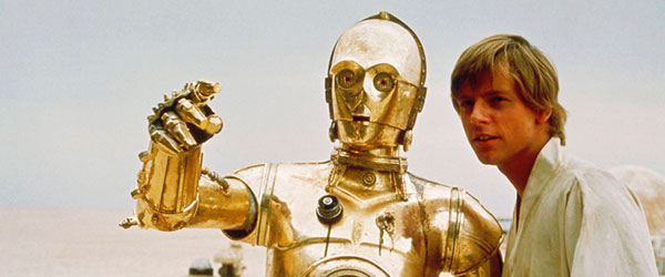 C-3PO et Luke Skywalker dans Star Wars Episode IV
